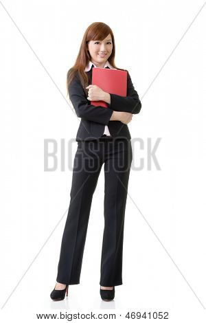 Asian business woman hold an file document, full length portrait isolated on white background.
