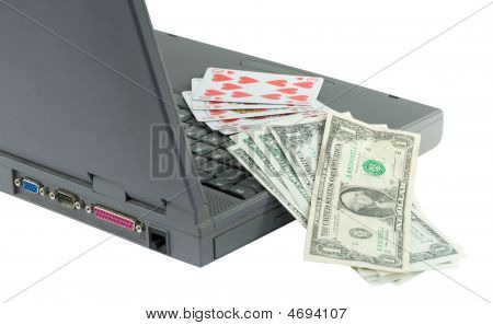 Laptop, Playing Cards And Dollars