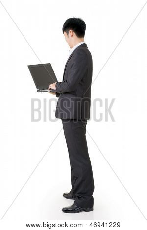 Rear view of Asian business man use laptop, full length portrait isolated on white background.