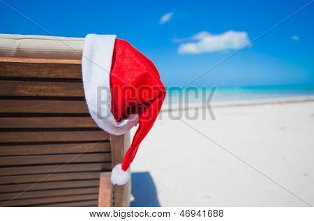 Close-up Santa Hat On Chair Longue On Tropical Caribbean Beach