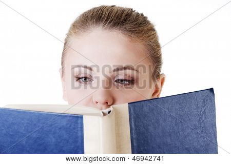 Girl reading a book, isolated on white background