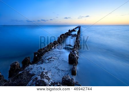 Long Old Wooden Dike In North Sea