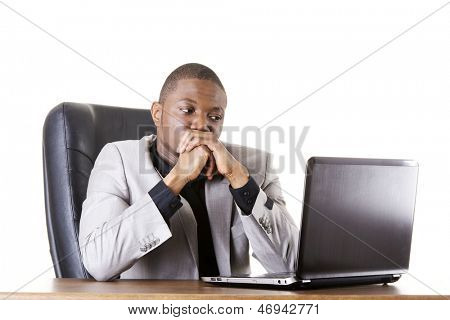 Stressed businessman working on laptop, isolated on white
