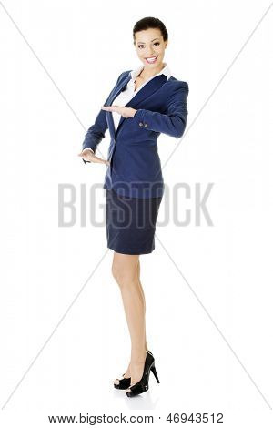 Happy young business woman showing , rounding and protecting copy space on her palm, isolated on white