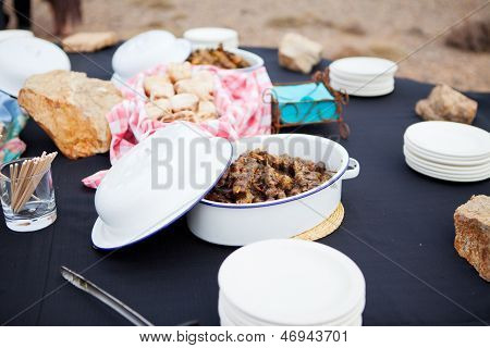 Fresh Mutton Meat Kebabs And Roasted Bread Served In Dishes