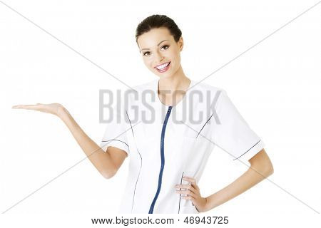 Medical doctor woman or nurse presenting and showing copy space for product or text, isolated on white background