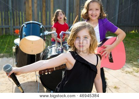 Blond kid singer girl singing playing live band in backyard concert with friends