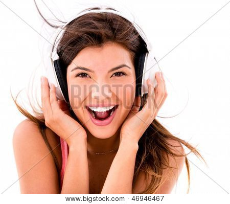 Happy woman listening to music with  headphones �¢?? isolated over white