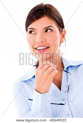 Pensive business woman looking up - isolated over a white background