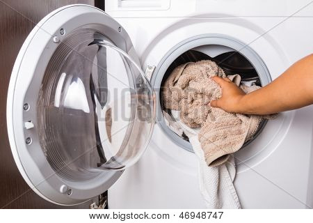 Hand loading laundry to the washing machine