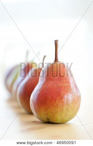 Fresh ripe red and green pears in a row
