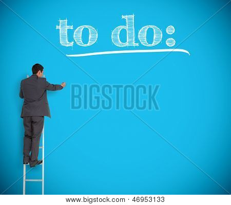 Businessman writing to do list on a giant blue wall helped by a ladder