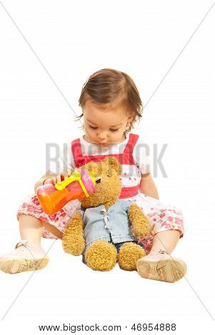 Toddler Girl Givng Juice To Her Bear Toy