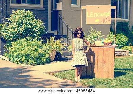 retro girl wearing sunglasses with lemonade stand