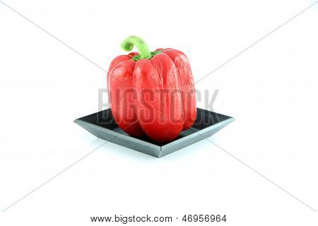 The Red Bell Pepper In The Black Dish.