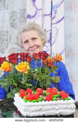 Elderly Woman With Roses