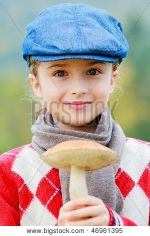 Mushrooms picking, season for mushrooms - lovely girl with picked fresh edible mushroom