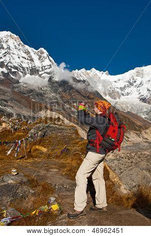 The Girl Takes Photo Of Mountains