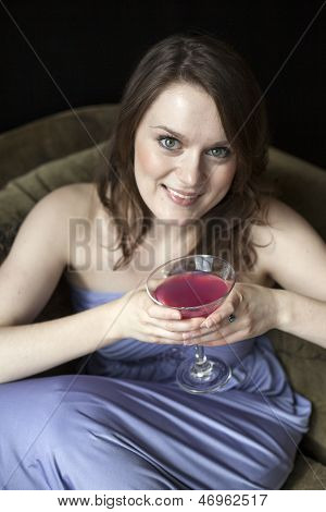 Young Woman With Beautiful Green Eyes Drinking Pink Martini