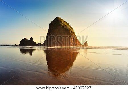 Haystack rock at sunset Oregon