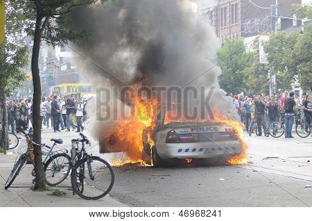 Burning police car.