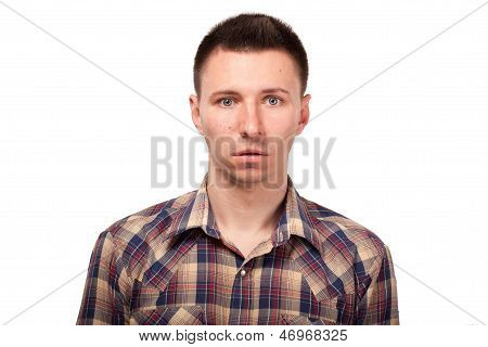 Surprised man in a plaid shirt