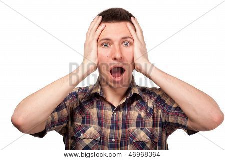 Frightened man in a plaid shirt shouts