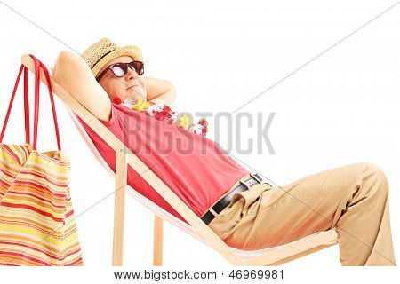 Mature male tourist enjoying on a beach chair isolated on white background