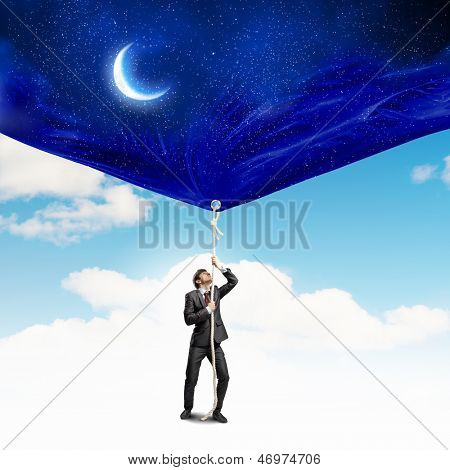 Image of businessman pulling banner with illustration. Day and night concept