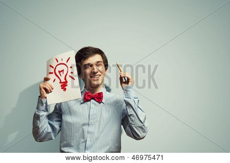 Image of young confused businessman holding notebook
