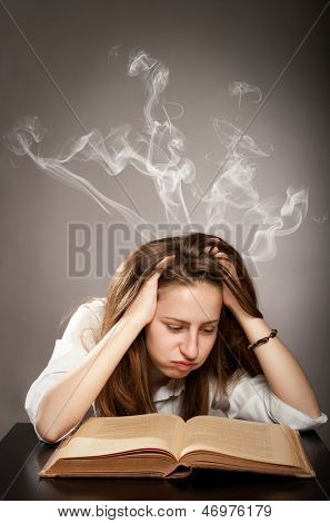 young woman reading a book with smoke over her head