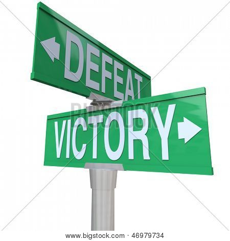 The words Victory and Defeat on two way street or road signs to illustrate the choice between winning or losing a game or competition