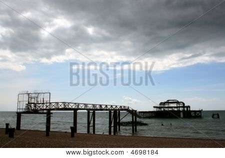Cloudy Sky With Pier Remains, Brighton, England Uk