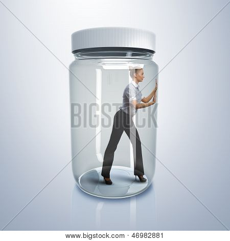 Businesswoman inside glass jar