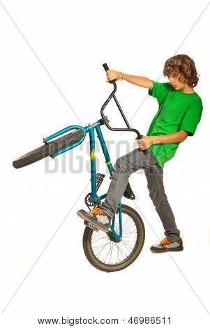 Teen Boy Trying Stunt On Bike