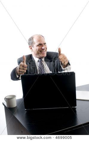 Excited Happy Senior Management At Desk Success
