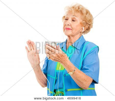 Senior Lady Listens To Music
