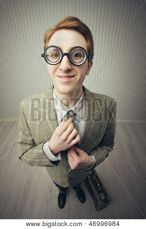 Salesman Smiling Adjusting Tie