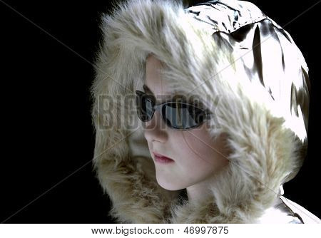 Teen girl wearing sunglasses and winter coat with fur lined hood