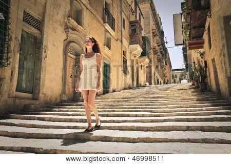 mediterranean woman walking in the city of Valletta in Malta