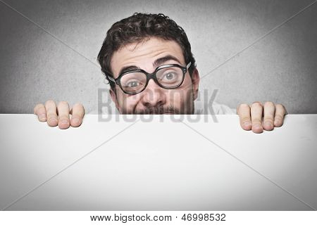 young man with glasses hidden