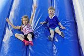 pic of inflatable slide  - Funny kids and off the inflatable slides - JPG