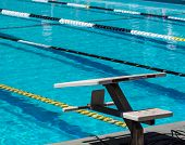picture of swim meet  - Swimming starting blocks at end of outdoor pool - JPG