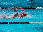 image of swim meet  - Freestyle swim heat with fast youth swimmer - JPG