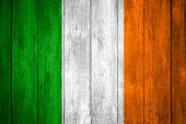 picture of irish flag  - Ireland flag or green white and orange Irish banner on wooden background - JPG