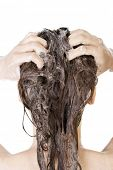 stock photo of douching  - Young woman in shower washing her hairs isolated on white background - JPG