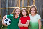 stock photo of three sisters  - three sister girls friends soccer football winner players on the backyard - JPG