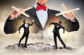 stock photo of male-domination  - Image of young businessman puppeteer - JPG