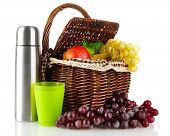 image of thermos  - Picnic basket with fruit and thermos isolated on white - JPG