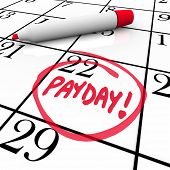 image of paycheck  - The word Payday circled in red marker on a calendar to remind you of the date you receive your wages - JPG